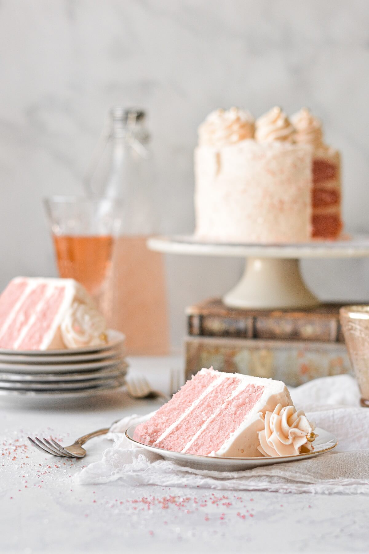 Slices of pink champagne cake.
