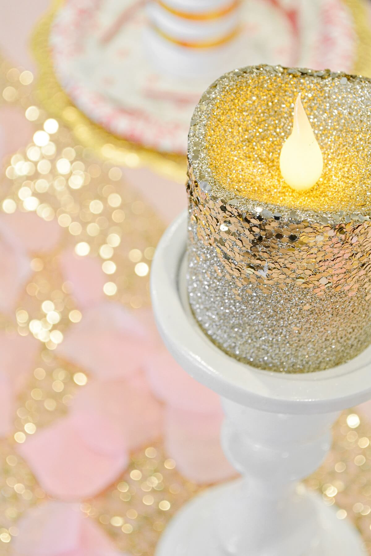 Gold sparkly candles for a pink and gold princess party.