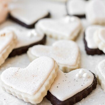 Heart shaped chocolate and vanilla sugar cookies, frosted with pale pink royal icing.