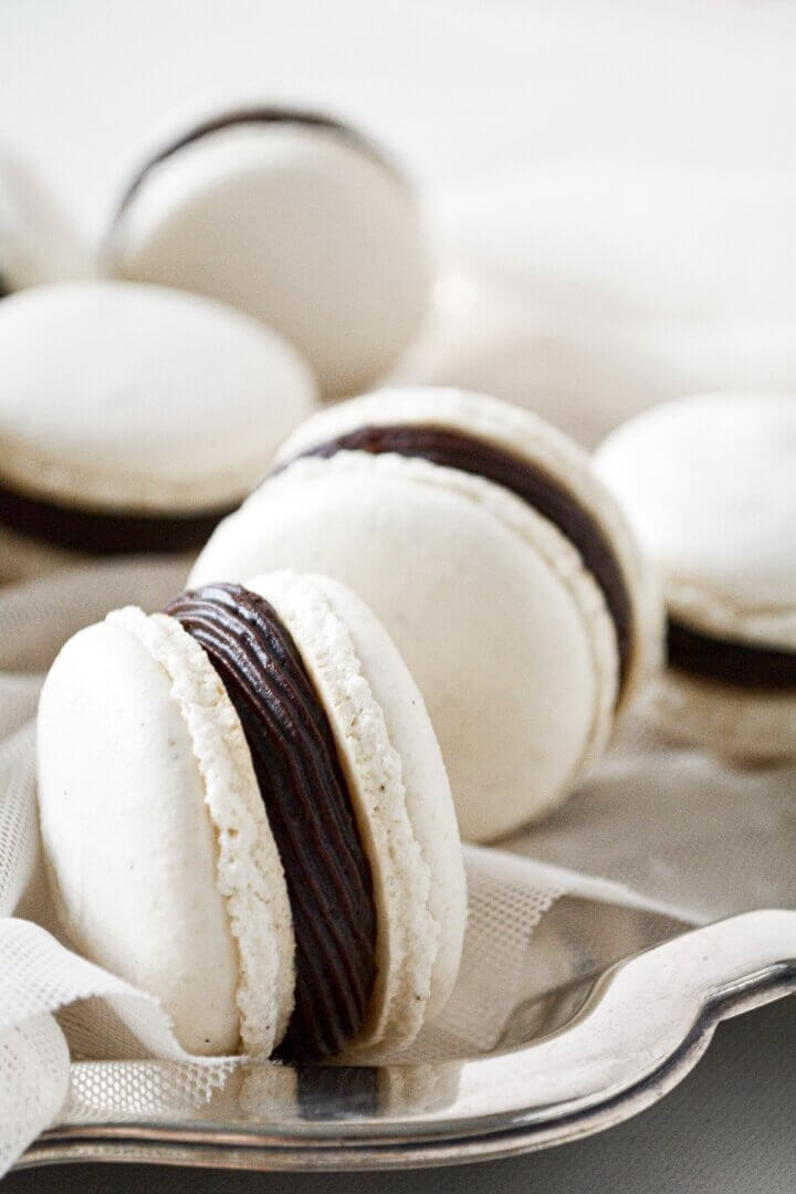 Vanilla bean French macarons, filled with chocolate buttercream.