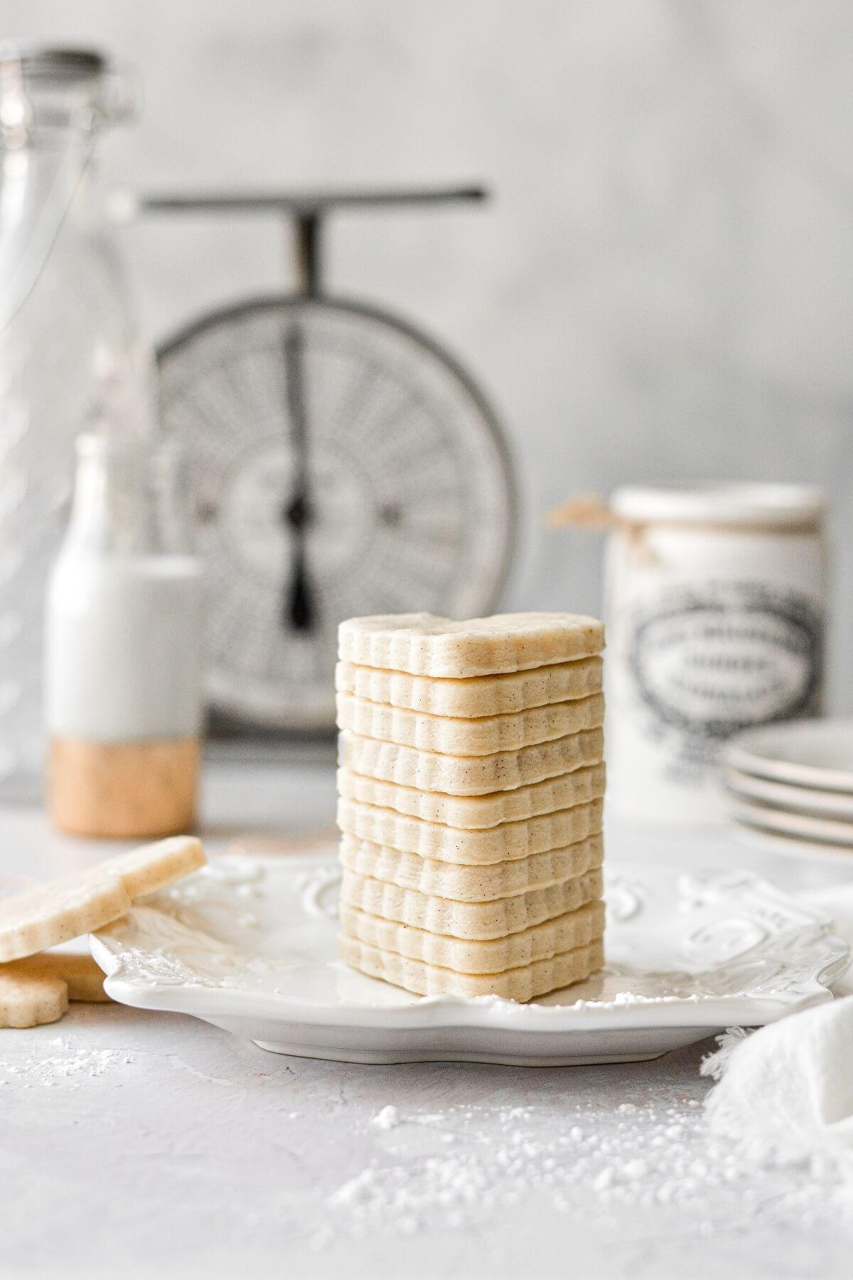 A stack of heart shaped vanilla bean sugar cookies.