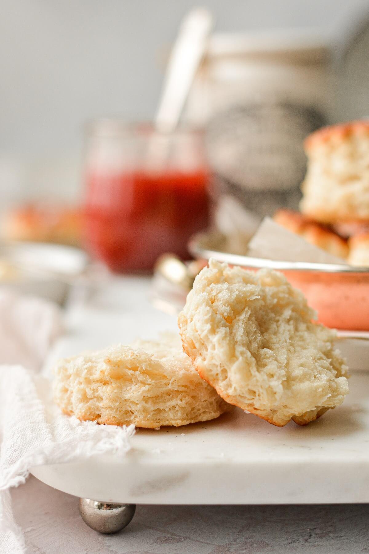 A fluffy baking powder biscuit, split in half.