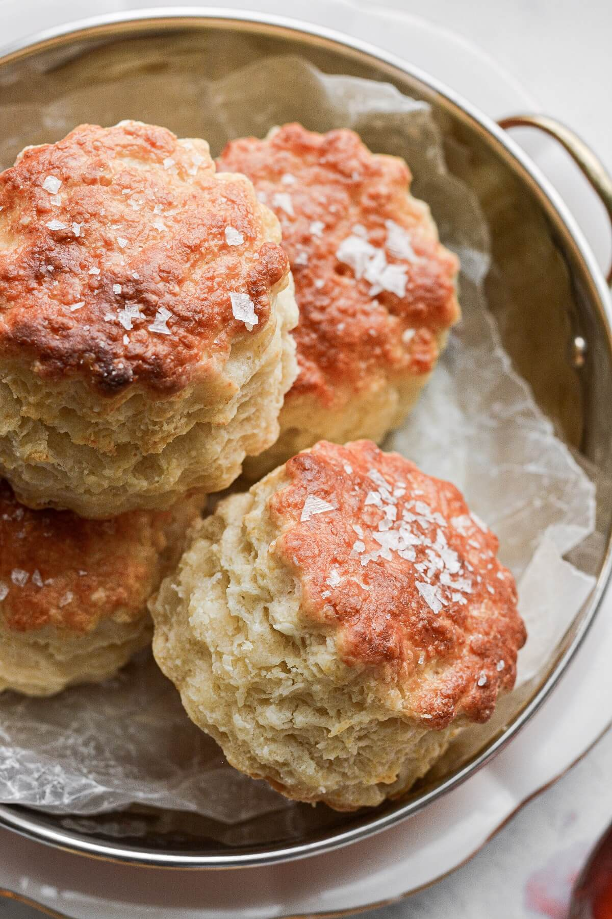 A bowl filled with baking powder biscuits.