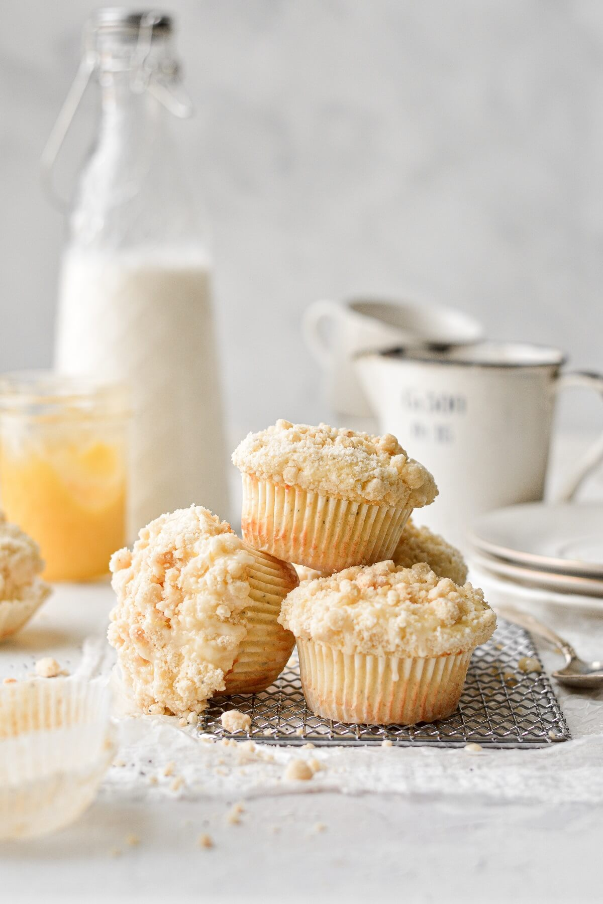 Lemon poppy seed crumb muffins, arranged on a cooling rack.