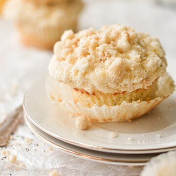 A lemon poppy seed crumb muffin on a plate.