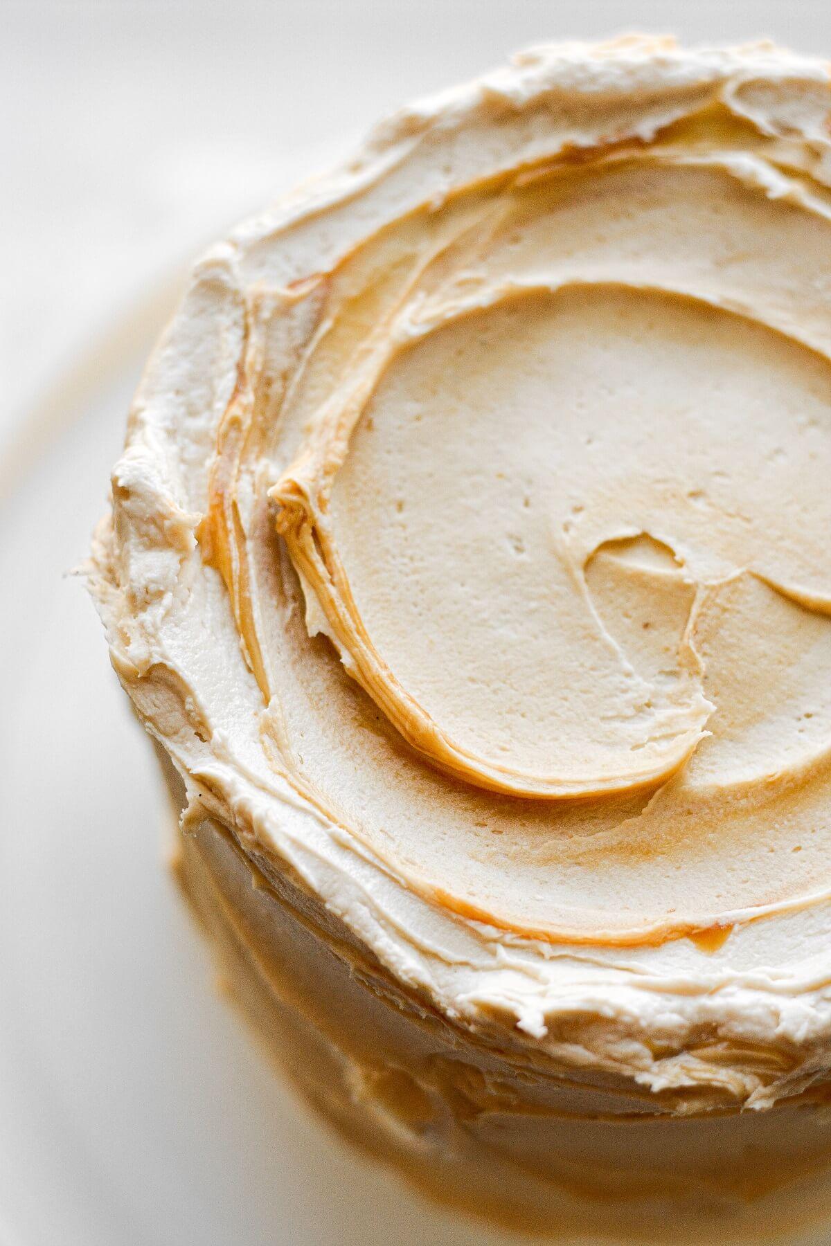 Swirls of salted caramel buttercream on a cake.