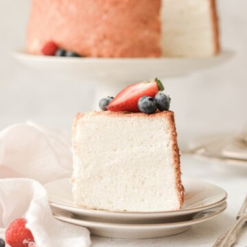 A slice of angel food cake topped with berries.