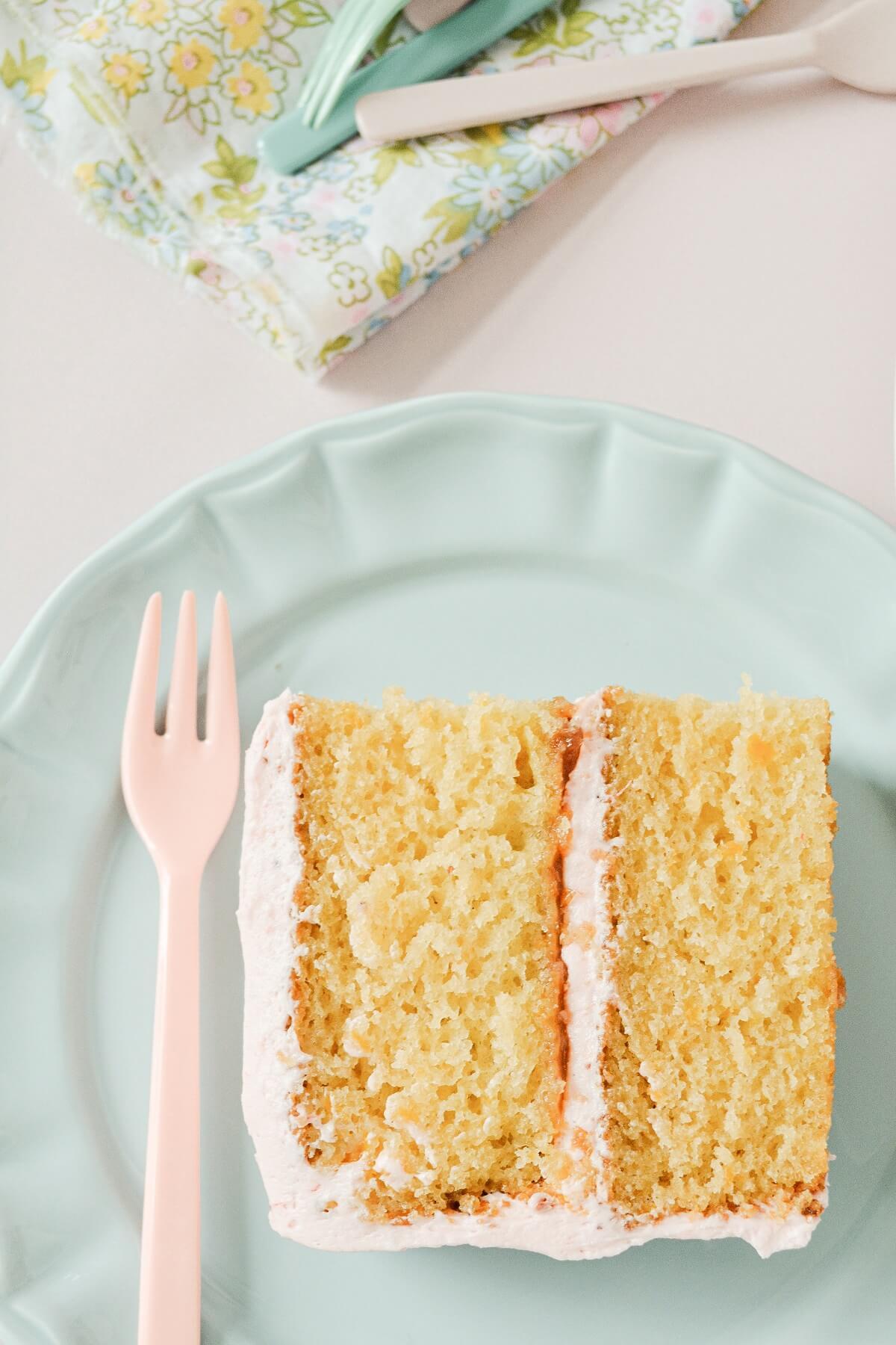 A slice of strawberry orange cake.