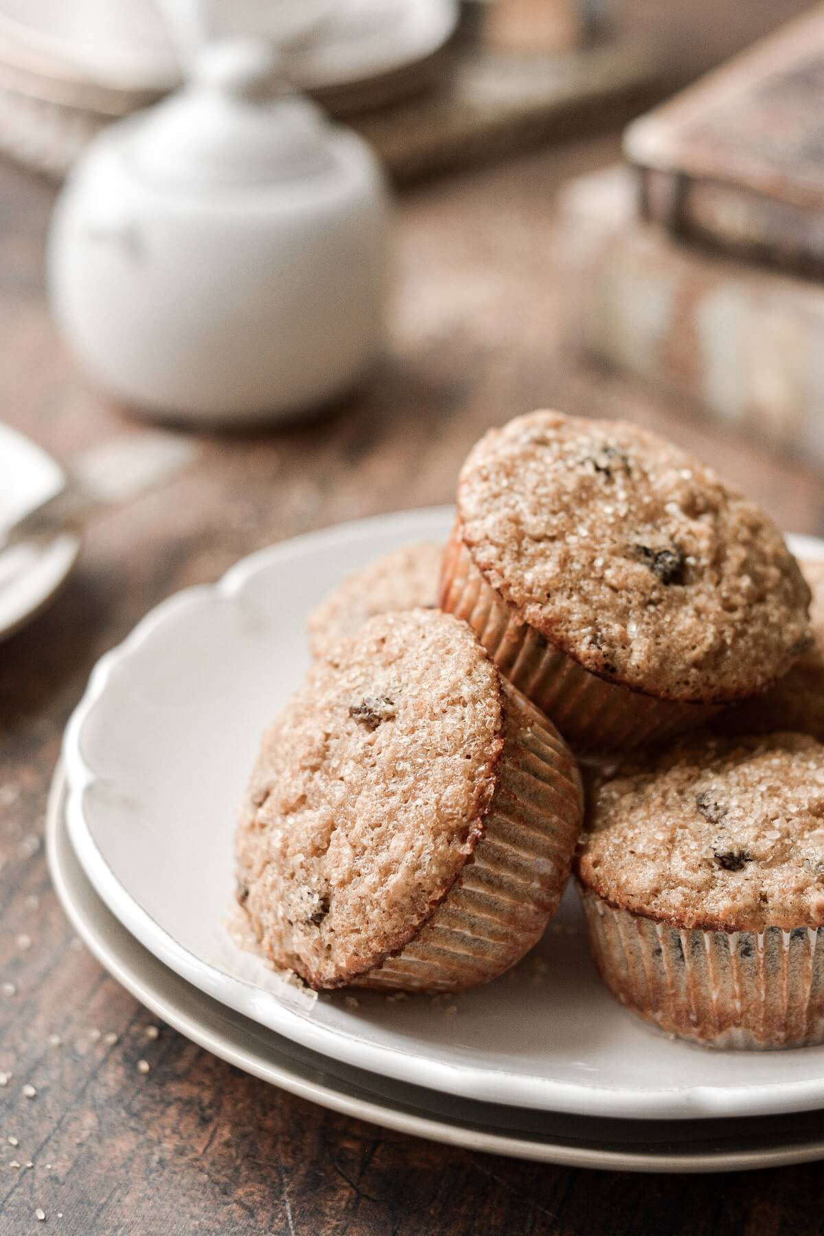 Oatmeal raisin muffins, piled on a plate.