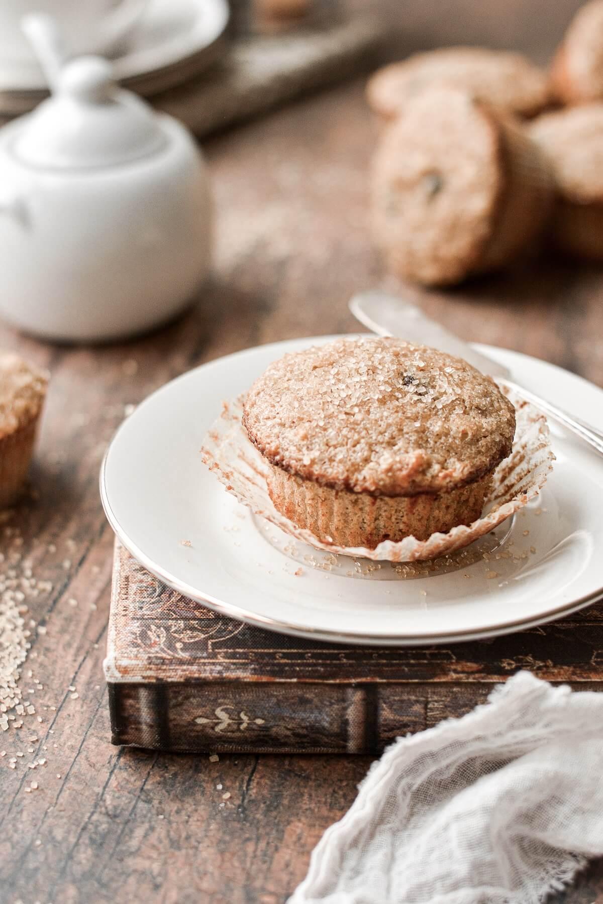 An oatmeal raisin muffin, sprinkled with coarse sugar.
