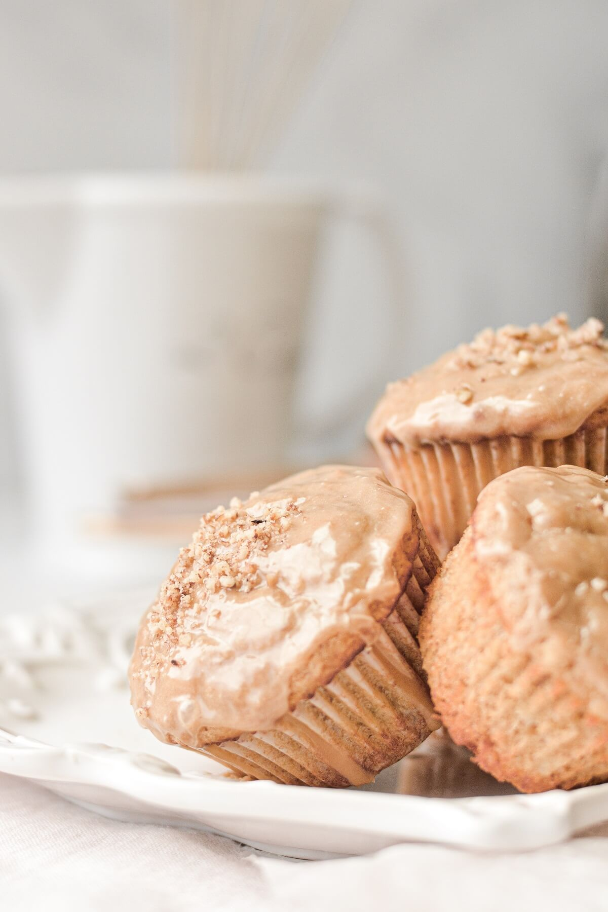 Banana pecan muffins, topped with maple icing.