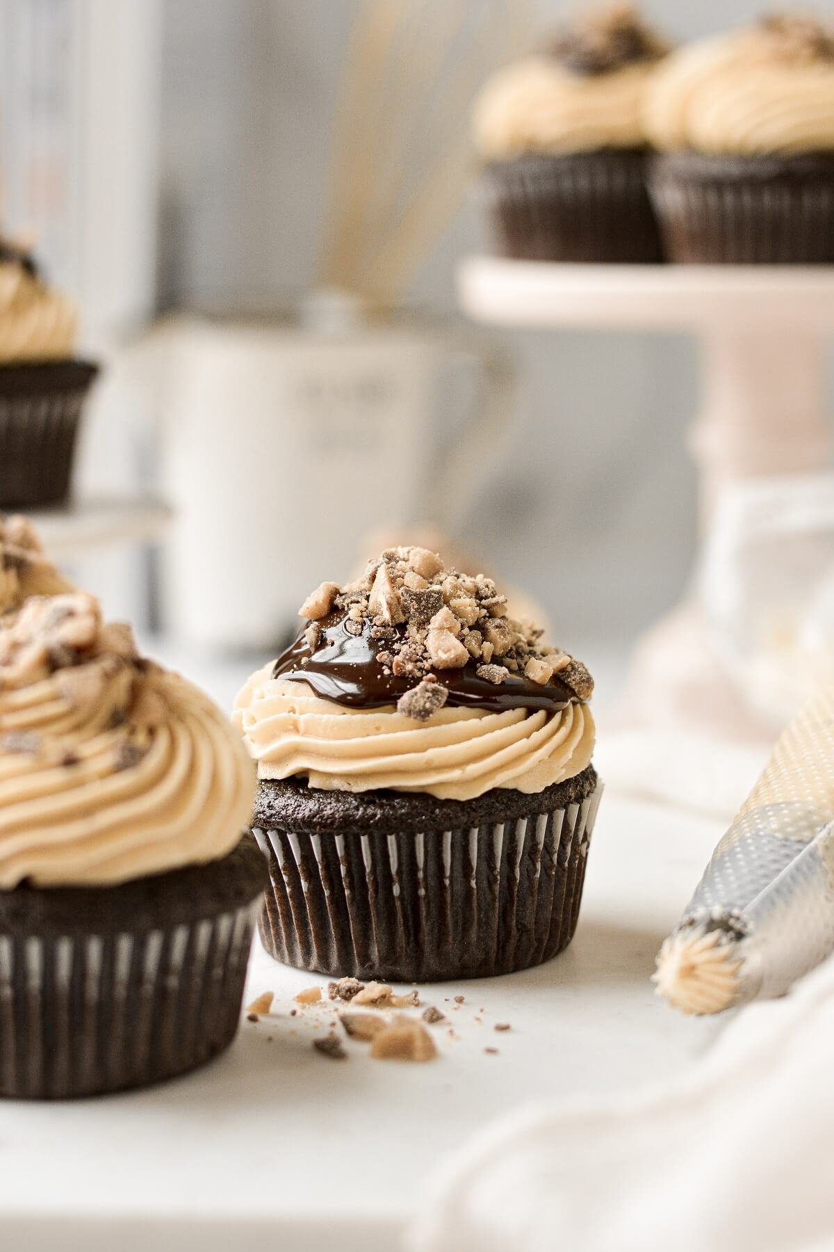 Chocolate truffle cupcakes, filled with ganache, topped with salted caramel buttercream and toffee bits.