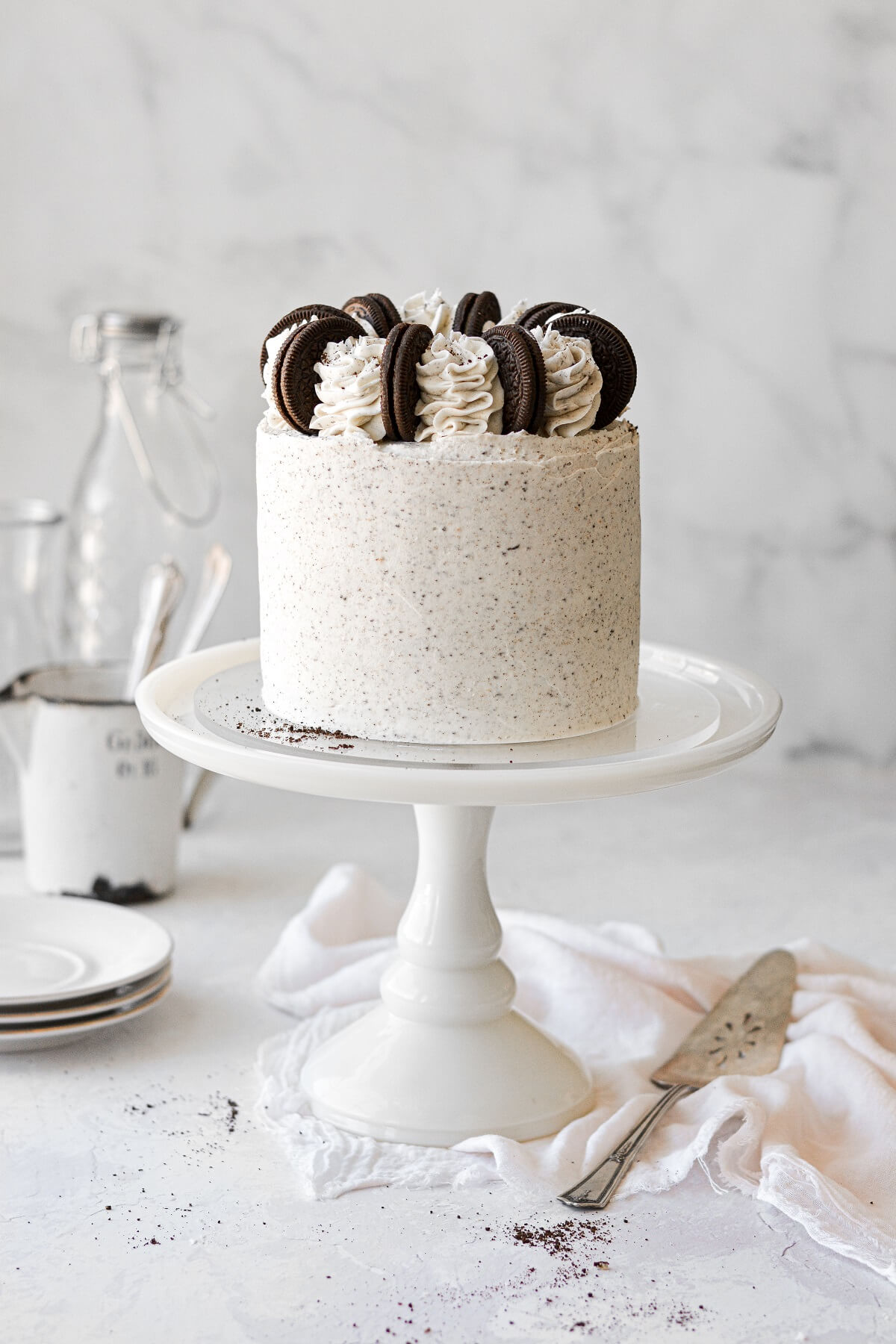 Cookies and cream cake, topped with Oreos and buttercream swirls.