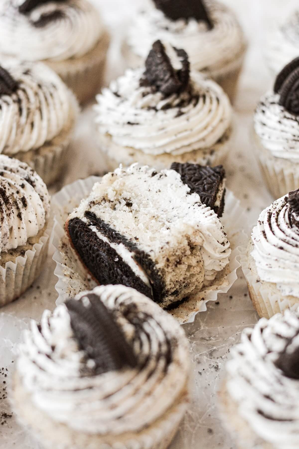 Cookies and cream cupcakes, one cut in half.