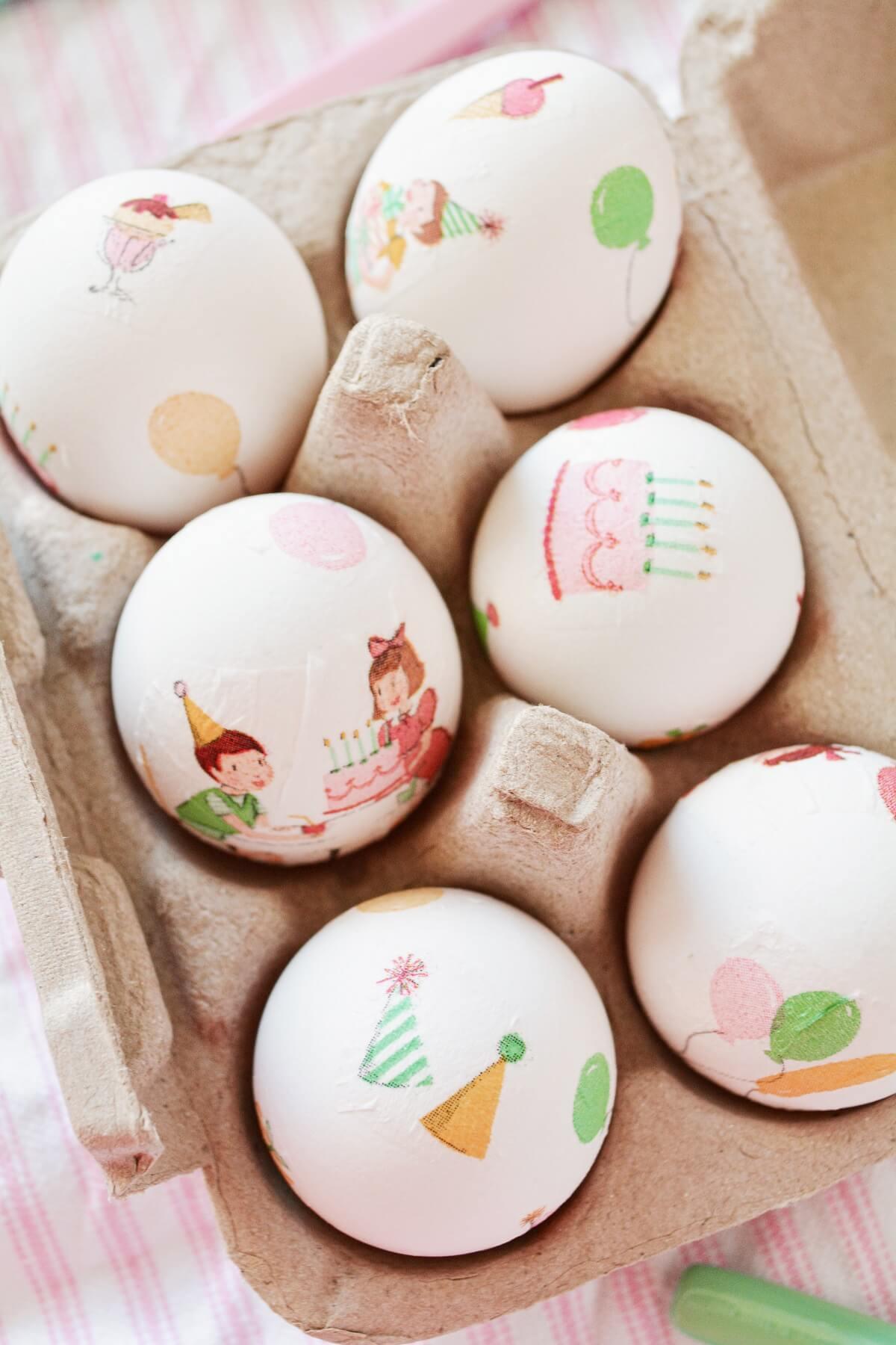 Decoupaged Easter eggs in a cardboard carton.