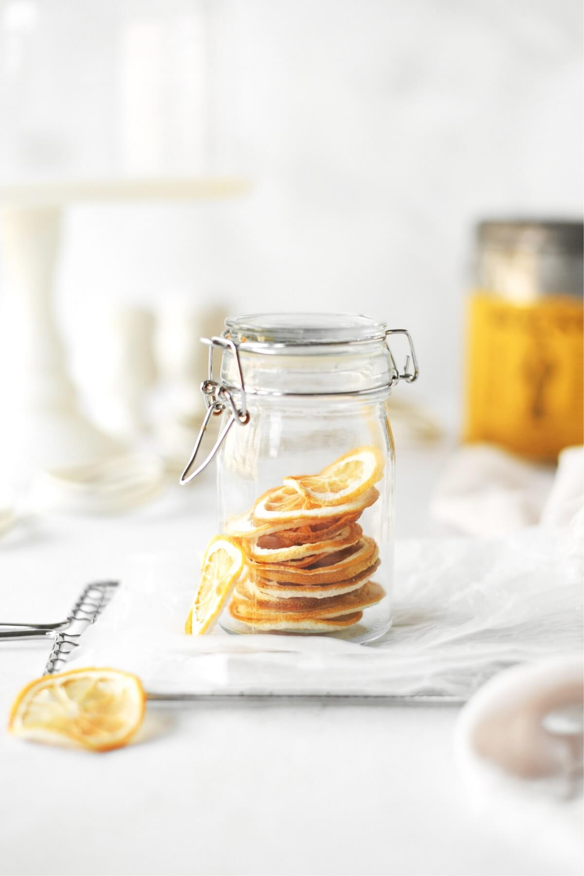 Dried lemon slices in a glass jar.