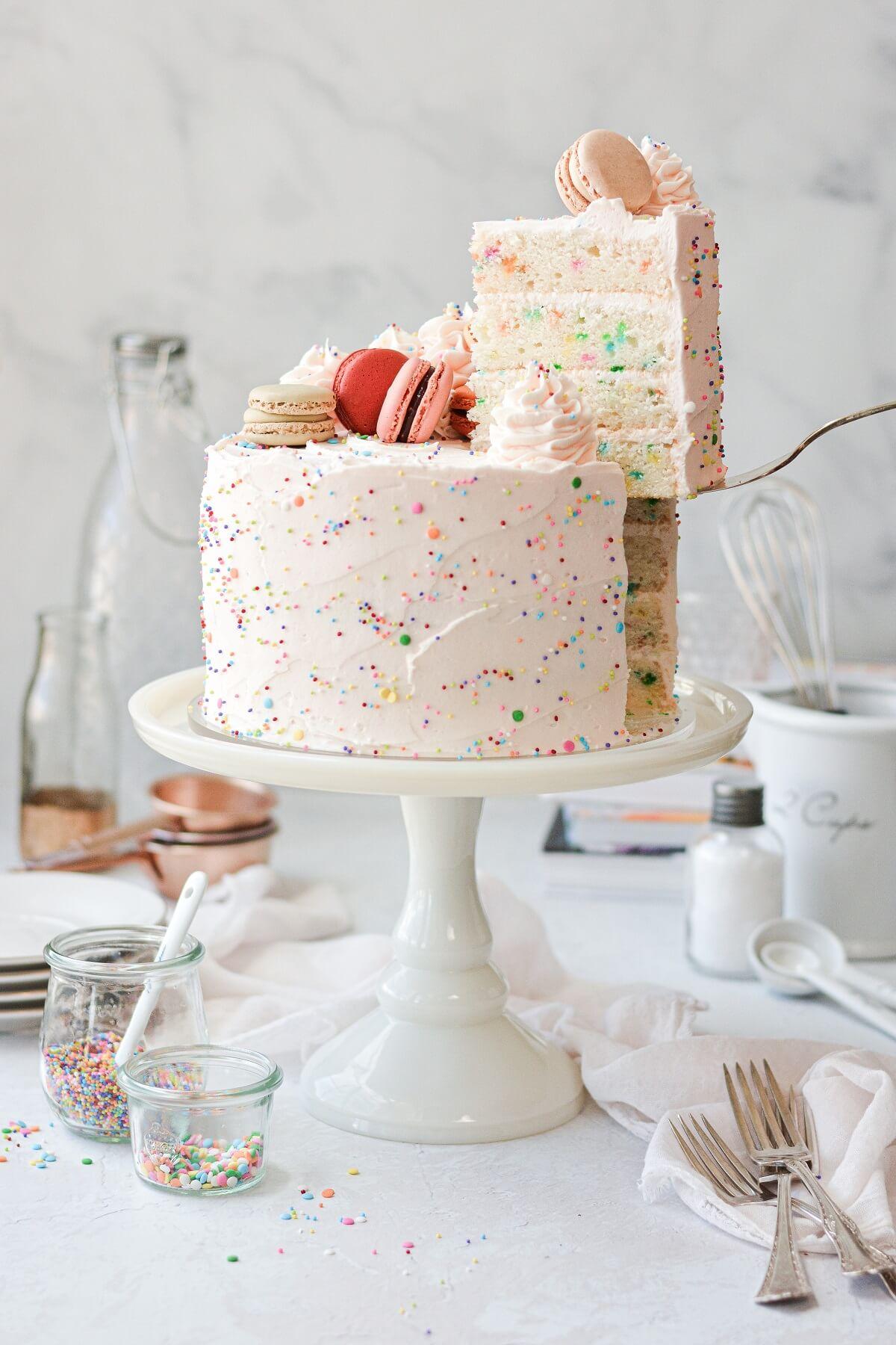 Funfetti cake with one slice cut.