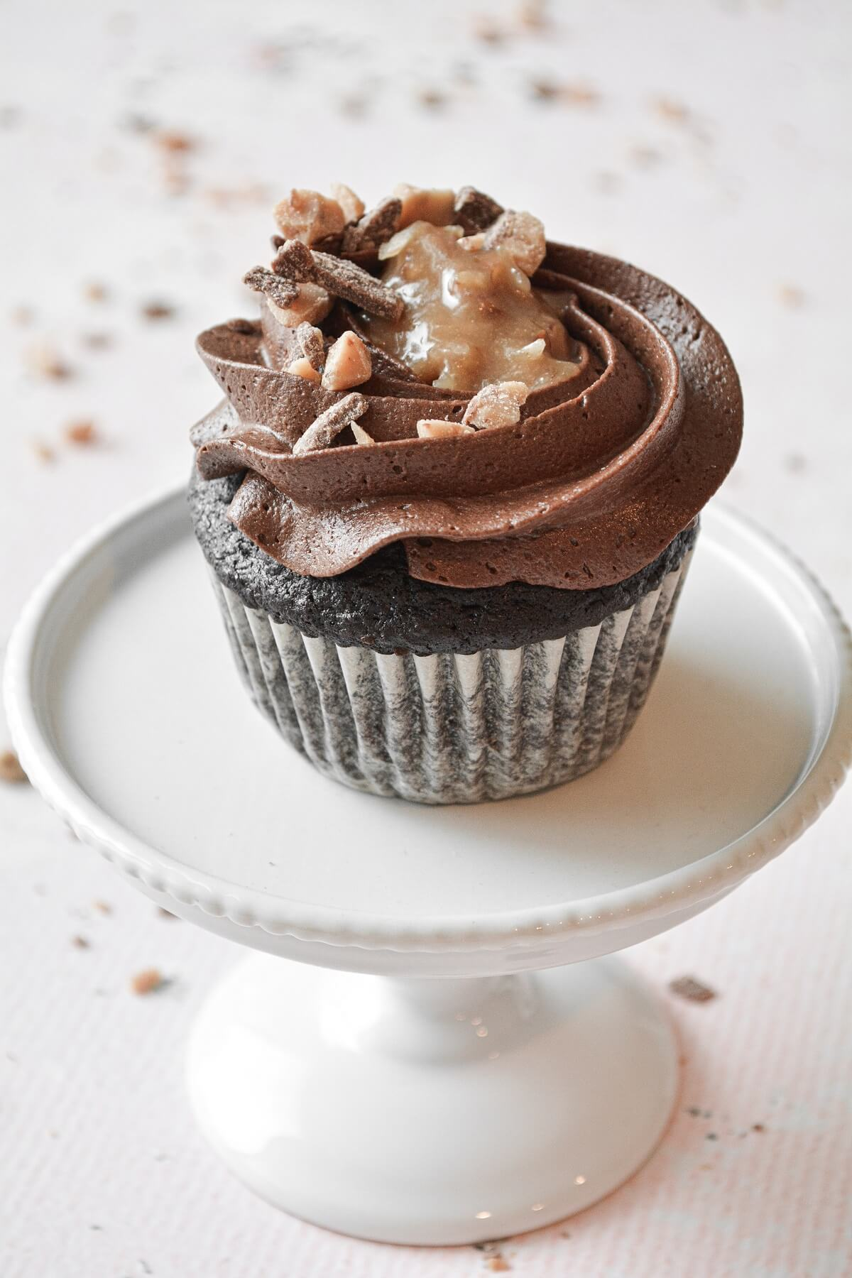 A German chocolate bourbon cupcake with chocolate buttercream and pecan, coconut caramel filling.