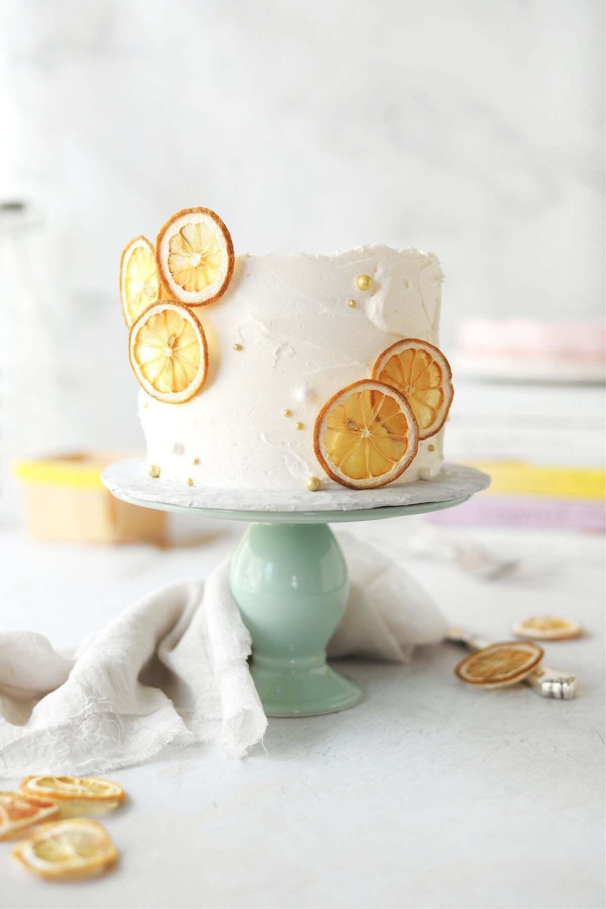 Lemon cake decorated with dried lemon slices.