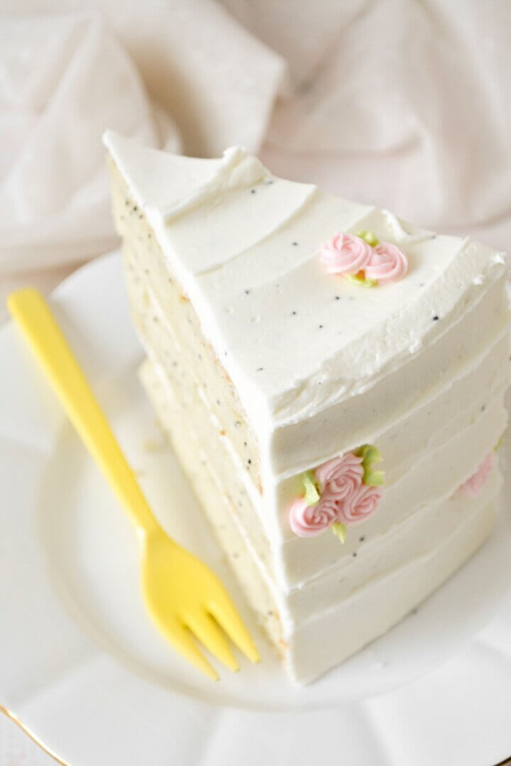 A slice of lemon cake with a yellow fork.