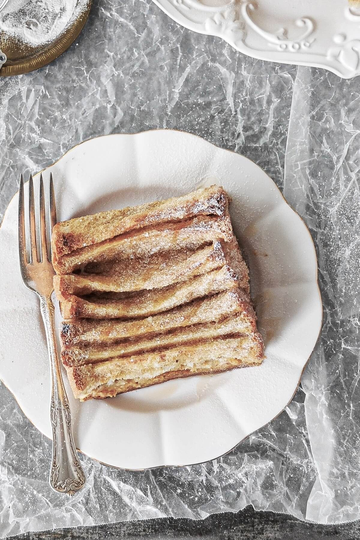 Baked overnight French toast, drizzled with syrup.