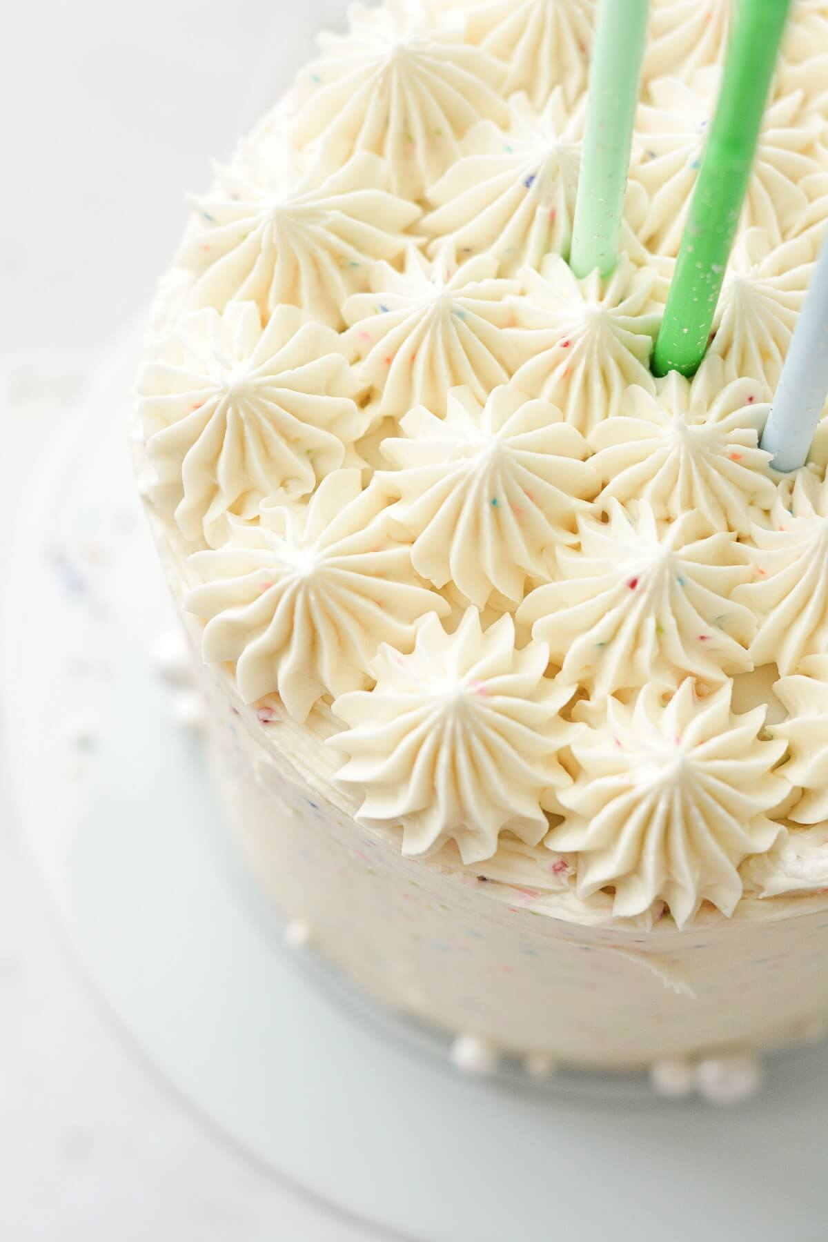 Piped buttercream on top of a birthday cake.