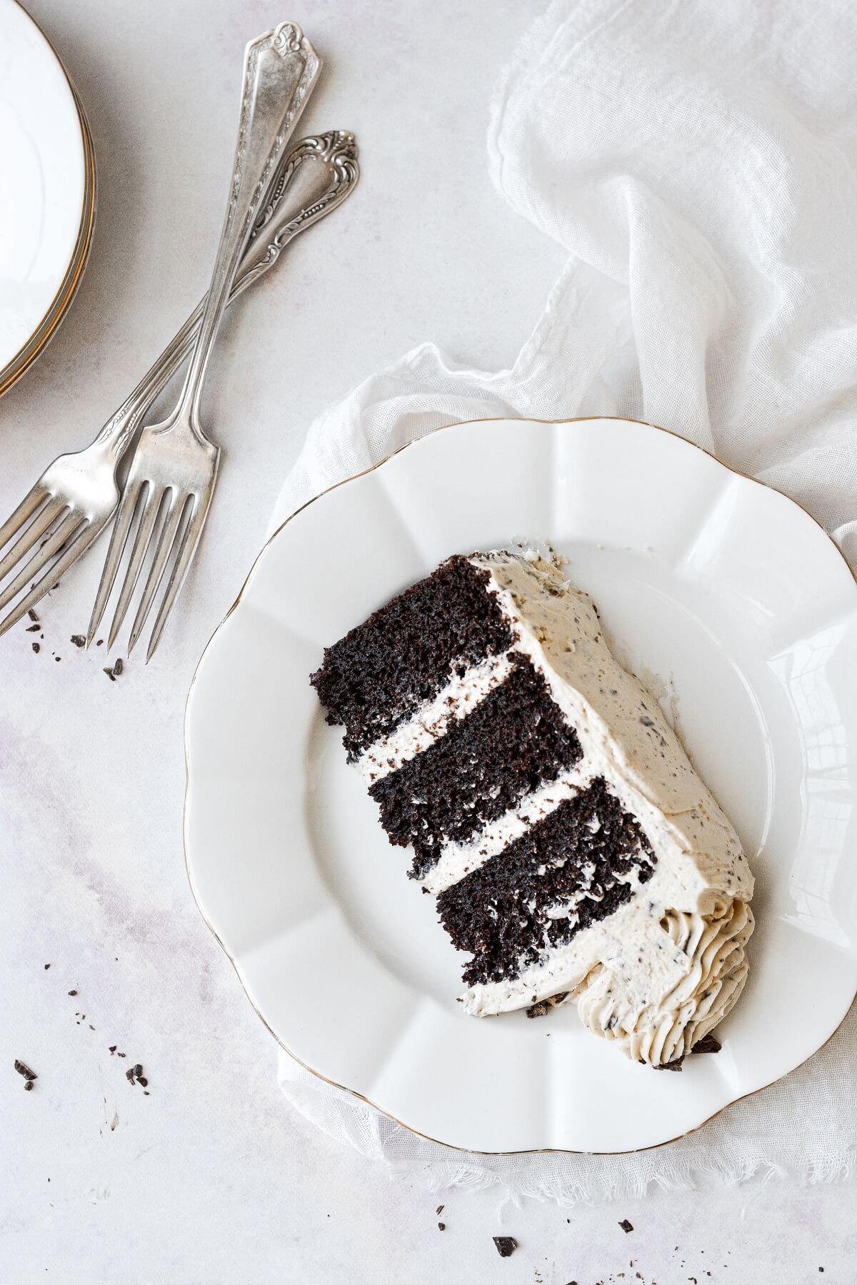 A slice of chocolate cake with peanut butter buttercream.