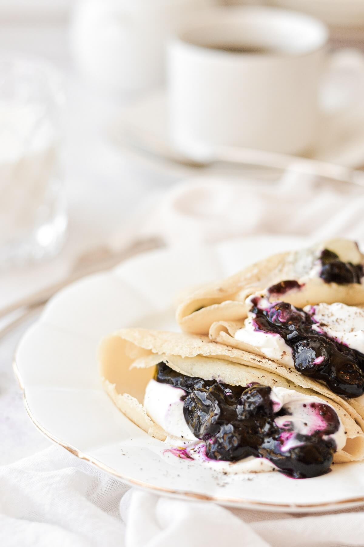 Crepes filled with whipped cream cheese and blueberry compote.