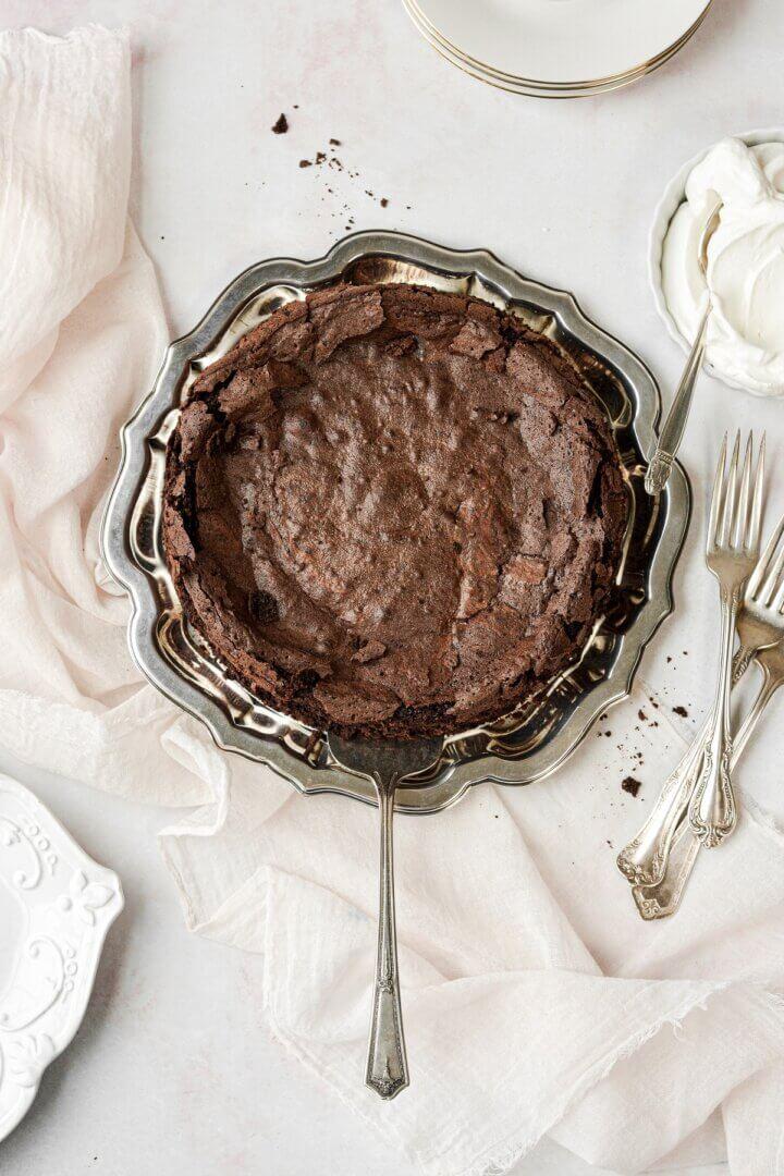 Flourless chocolate cake on a silver tray.