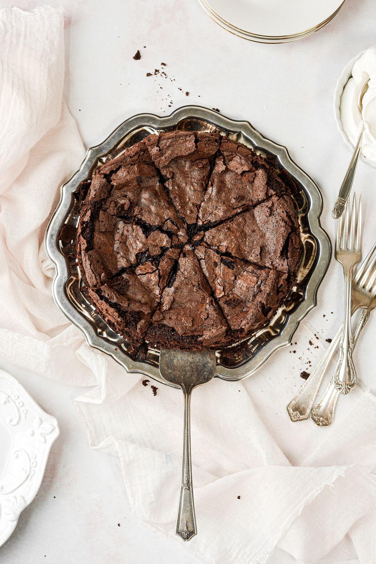 Flourless chocolate cake cut into 8 slices.