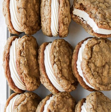 Homemade oatmeal cream pies in a tray.