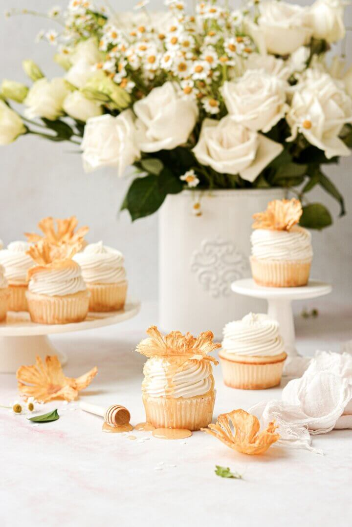 Honey lemon cupcakes topped with dried pineapple flowers.