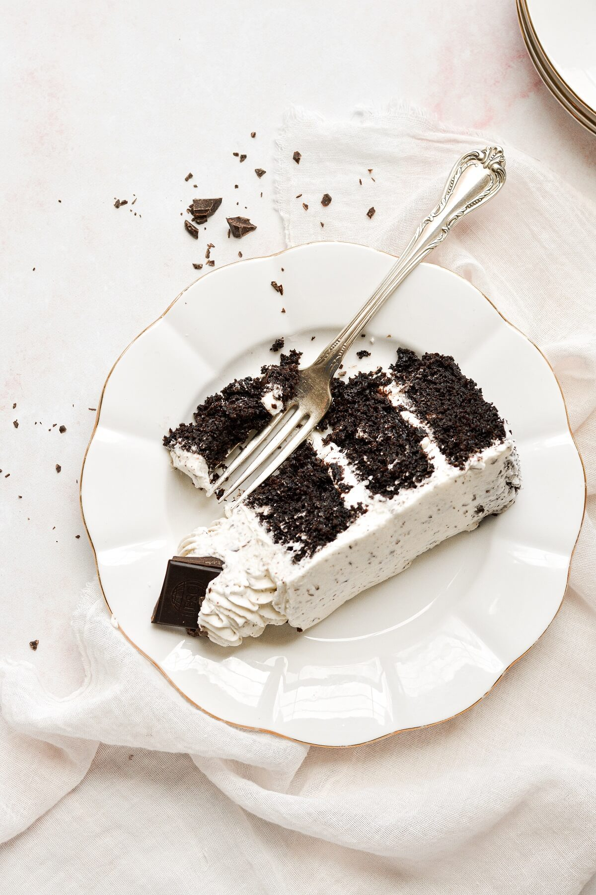 A slice of mint chocolate chip cake with a bite cut.