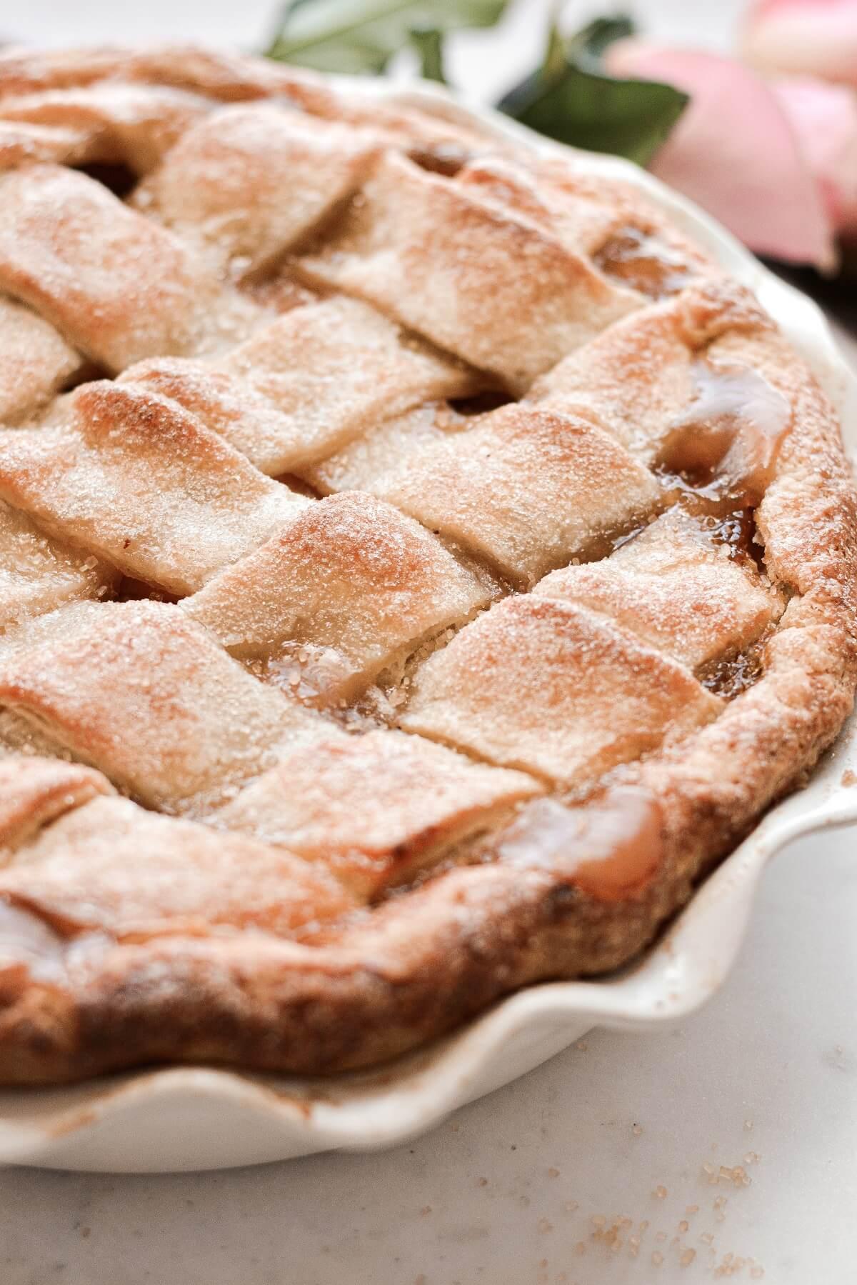 Closeup of the lattice crust on a peach pie.