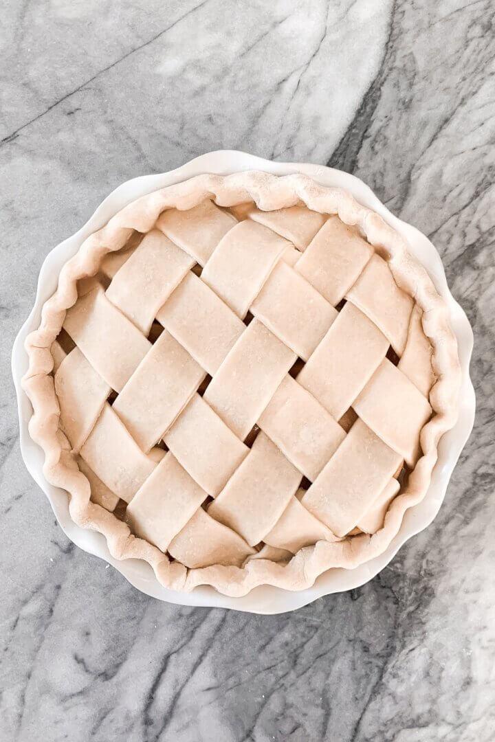 An unbaked peach lattice pie.