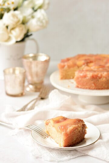 A slice of peach upside down cake.