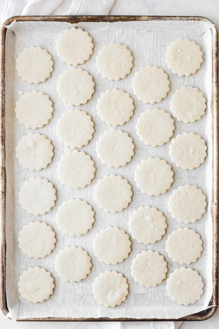 Shortbread cookies arranged on a baking sheet.