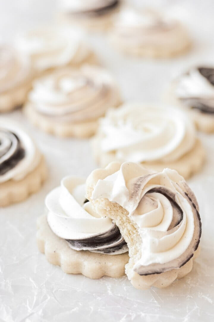 Shortbread cookies frosted with a swirl of chocolate and vanilla buttercream.
