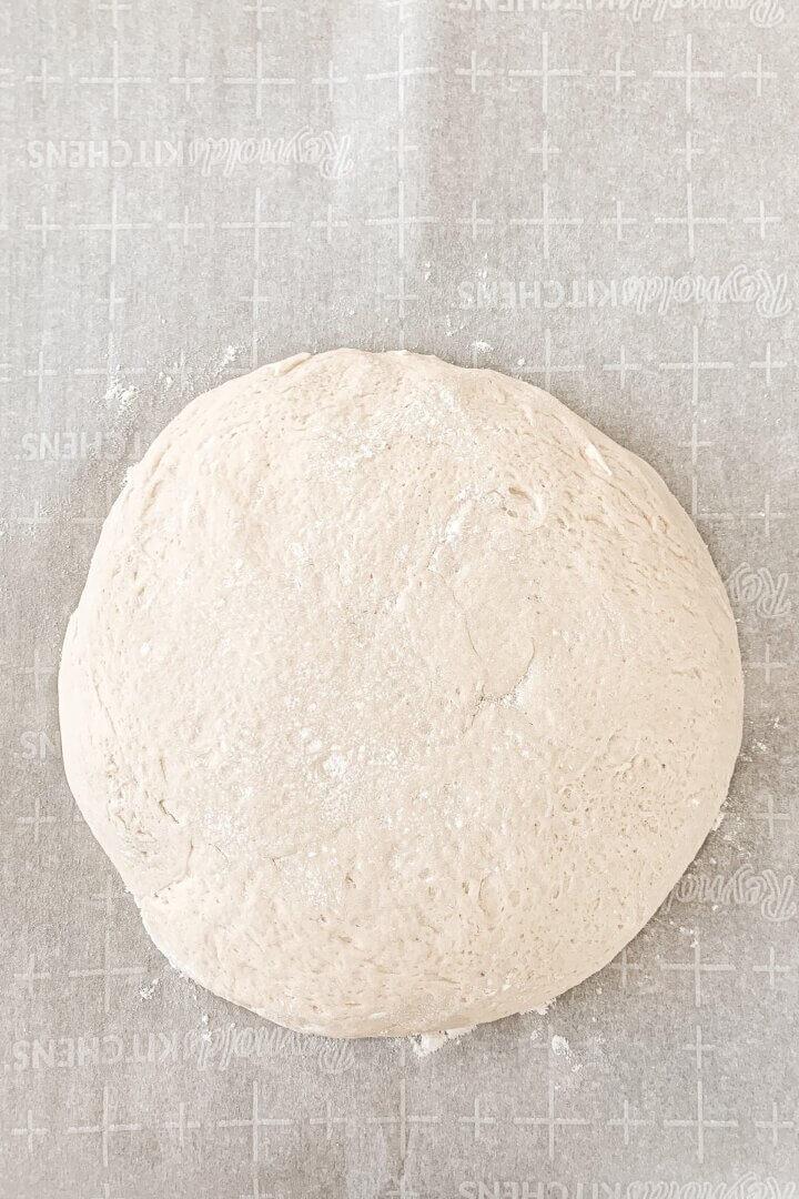 Soft pretzel dough on parchment paper.