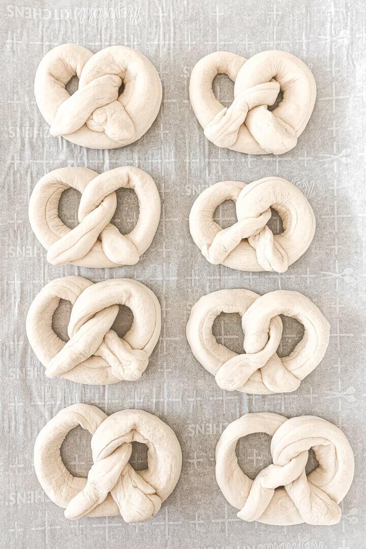 Soft pretzel dough, shaped into pretzels.