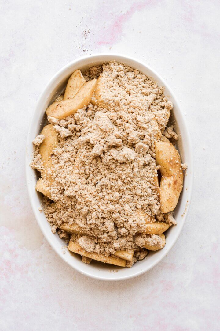 Apples sprinkled with crumb topping.