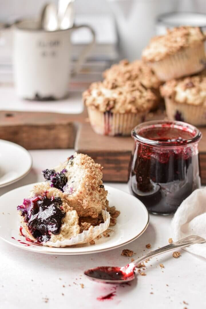 Blueberry muffins, spread with blueberry jam.