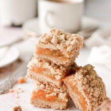 A stack of brown butter peach crumb bars.