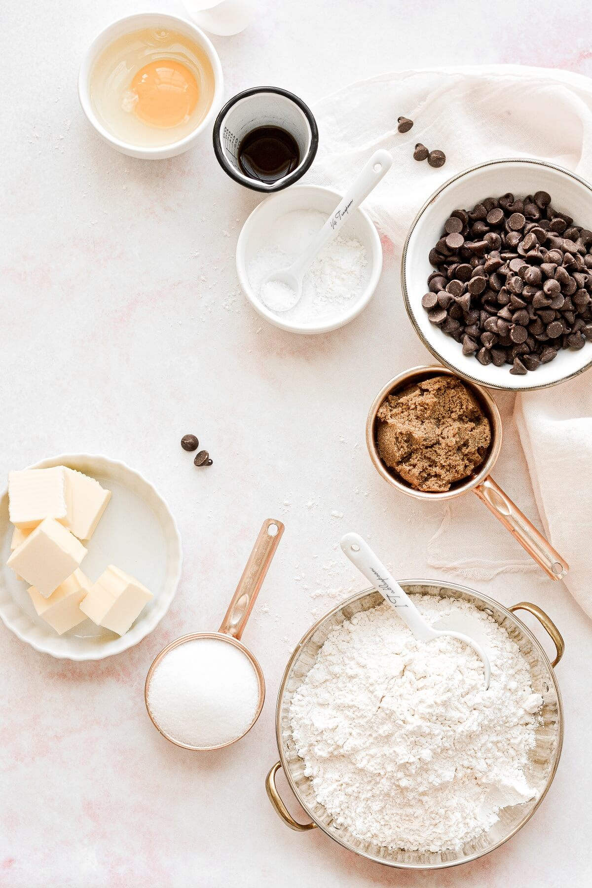 An arrangement of ingredients for chocolate chip cookies.