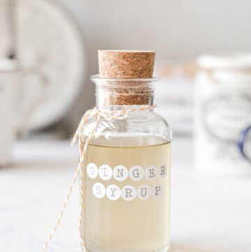 A glass jar filled with ginger simple syrup.