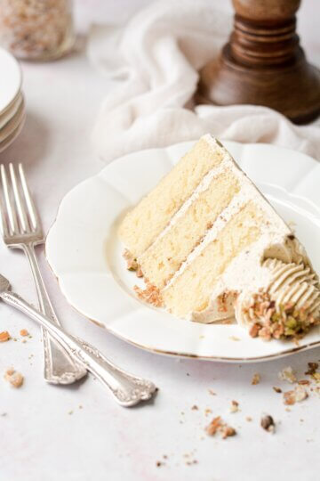 A slice of orange pistachio cake.