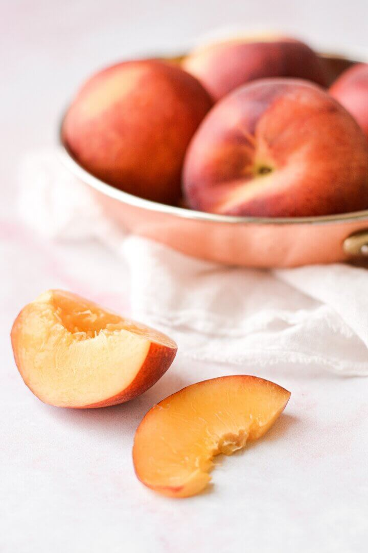 Fresh peaches in a bowl.