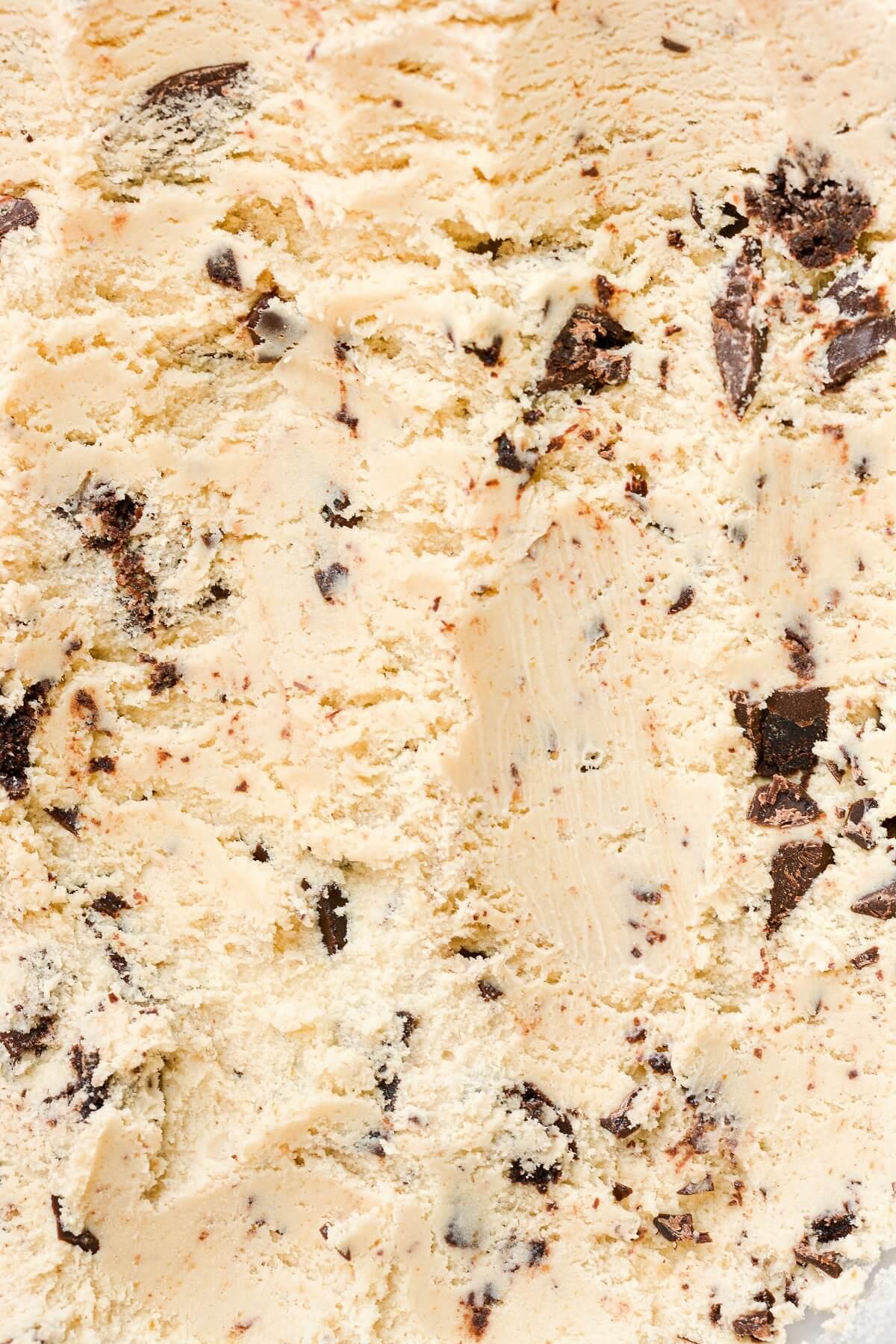 Closeup of pistachio browni chunk ice cream.