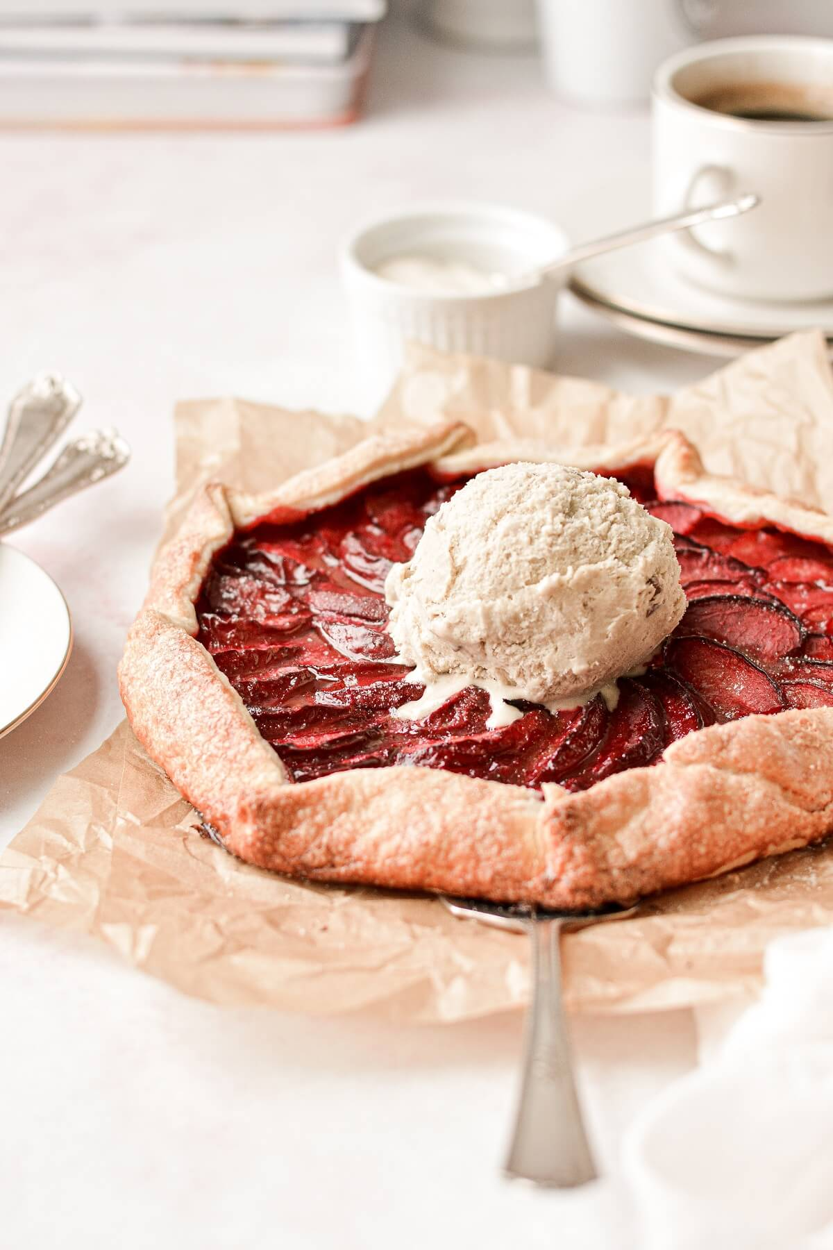 Plum galette topped with a scoop of ice cream.