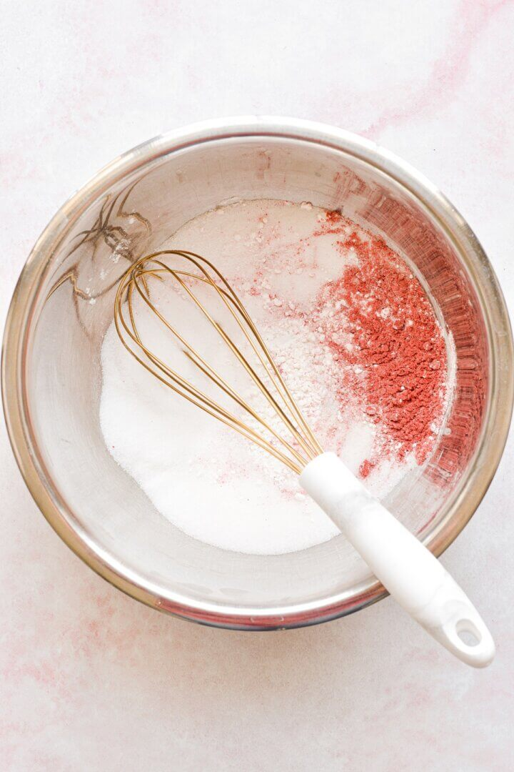 A bowl of ingredients for homemade rhubarb curd.